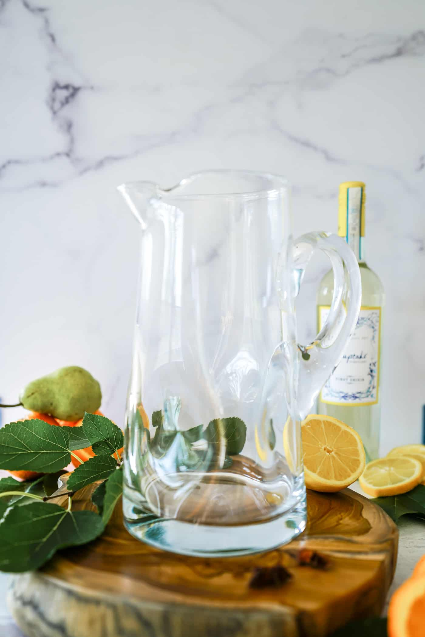 A large Crate and Barrel glass pitcher for apple cider sangria recipe.